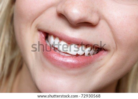 A sensational smile of a happy and healthy young female. - stock photo
