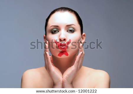 a sensual white lady with X on her lips - stock photo