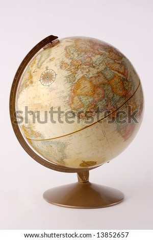 A sepia earth globe isolated - stock photo