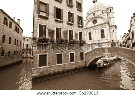 A sepia-toned photograph of two canals with the church of  Santa Maria dei Miracoli in the background.