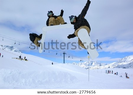 a serie of a snowboarder jumping high through a blue sky - stock photo