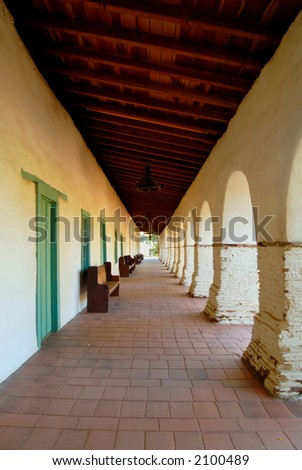 A series of arches along the main walkway of the San Juan Bautista Mission - stock photo