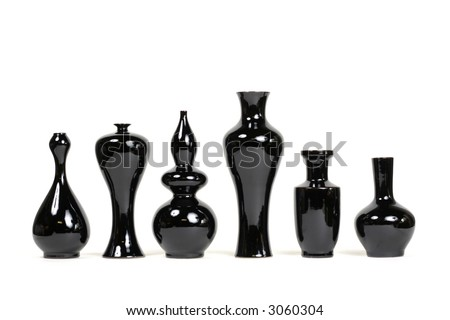 A series of 6 chic modern black vases - stock photo