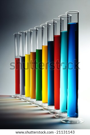 A series of cylinders with colorful chemicals - stock photo