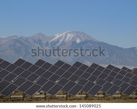 A series of large solar panels forms a symmetrical line at a power plant in the San Luis Valley of central Colorado.