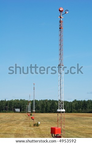 A series of light tower at an airport - stock photo