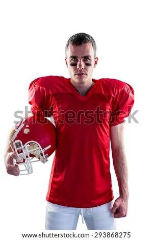 A serious american football player looking at camera with white background