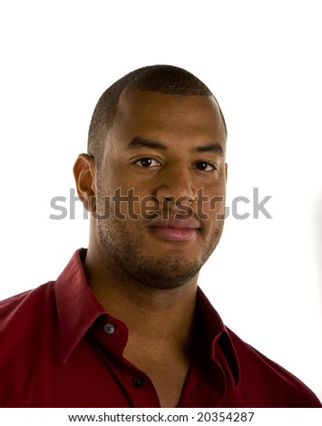 A serious looking black man in a red shirt looking at camera