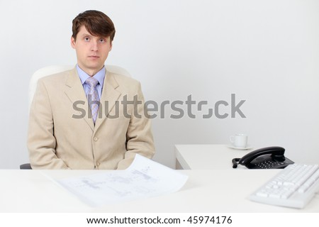 A serious man in a business suit at work in the office