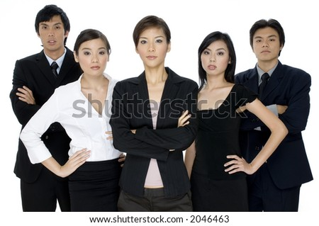 A serious young business team standing on white background - stock photo