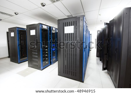 A server room with black servers - stock photo