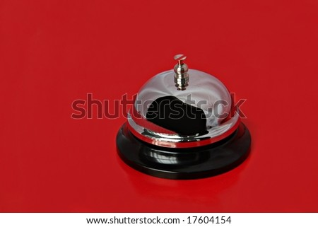 A service bell isolated on a bright red background - stock photo