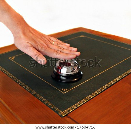 A service bell on a hotel reception desk - stock photo