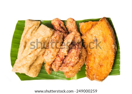 A serving consisting of the combination of fried banana (pisang goreng), fried sweet potatoes (keledek goreng) and fish nuggets (keropok lekor), a popular snack in Malaysia. - stock photo