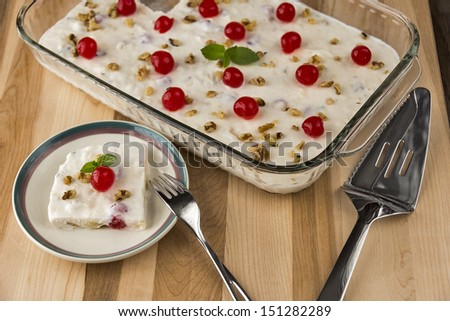 A serving of delicious frozen fruit salad throws a twist on the traditional fruit salad. One image in a series. - stock photo