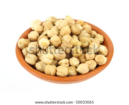 A serving of dried garbanzo beans in a small terra cotta bowl - stock photo