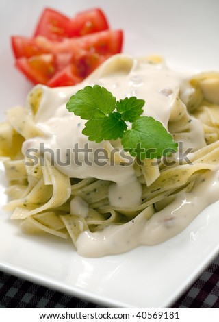 a serving of fresh and delicious pasta carbonara - stock photo