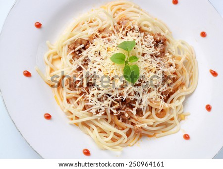 a serving of Italian spaghetti with sauce bolognese and a meat, isolated on white background - stock photo