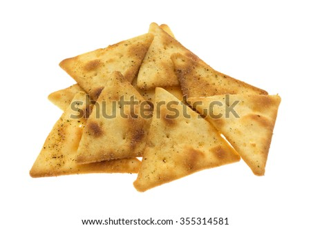 A serving of pita crispy snack crackers isolated on a white background. - stock photo