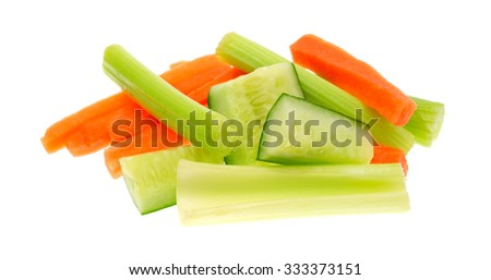 A serving of snack vegetables with cucumbers celery and carrots isolated on a white background. - stock photo