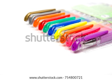 A set  colored pens on a white background