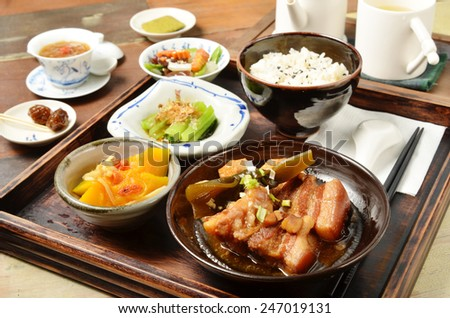 A set menu  stew pork with salad rice and soup .  - stock photo