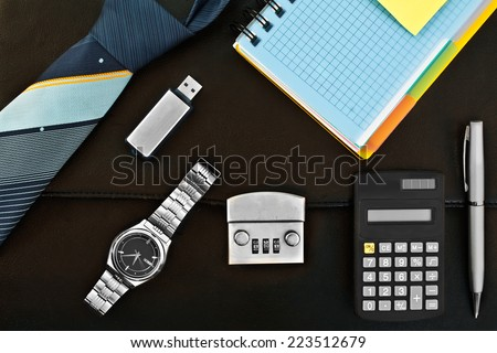 A set of accessories for the business on a leather briefcase - stock photo