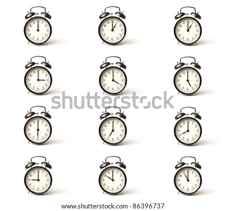 A set of alarm clocks showing every whole hour over white background with copy space - stock photo