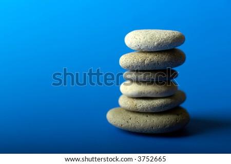A set of balanced round smooth stones - stock photo