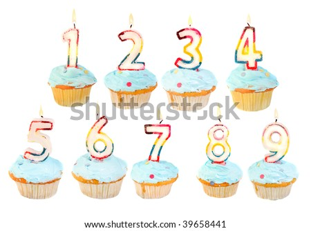 A set of birthday cupcakes with lit candles with numbers 1 to 9 - stock photo