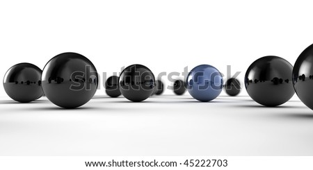 A set of black and blue balls as concept for teamwork, isolated on white background - stock photo