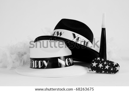 A set of black and white hats and New Year noise makers to ring in the New Year. - stock photo