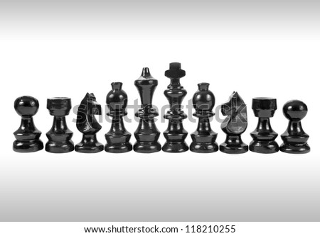 A set of black chess pieces isolated on a white background