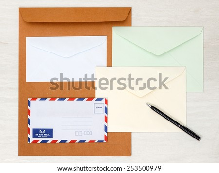 A set of blank envelopes with paper and pen view 4