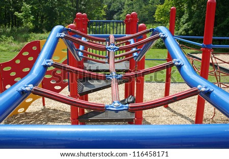 A set of blue bars in an empty playground - stock photo