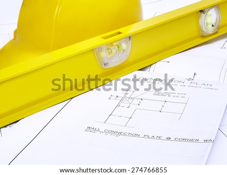 A set of blueprints with hardhat and level