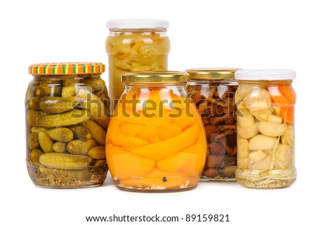 a set of canned vegetables. cucumbers, peppers, mushrooms and carrots. isolated - stock photo