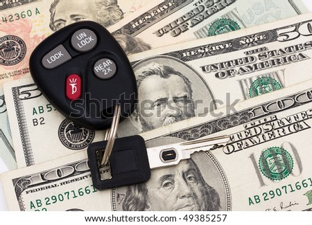 A set of car keys with cash, car payment - stock photo