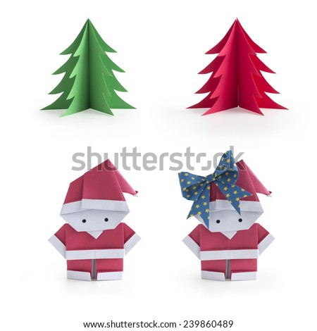 A set of Christmas origami paper craft: Mr. and Ms. Santa Claus and green and red Christmas trees isolated on white background - stock photo