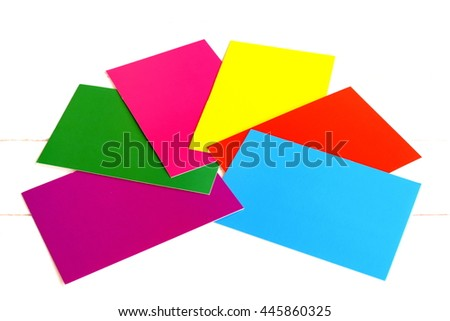 A set of colored cardboard isolated on white background. Red, yellow, green, blue, purple, pink paper sheets. A kit for children's craft and creativity