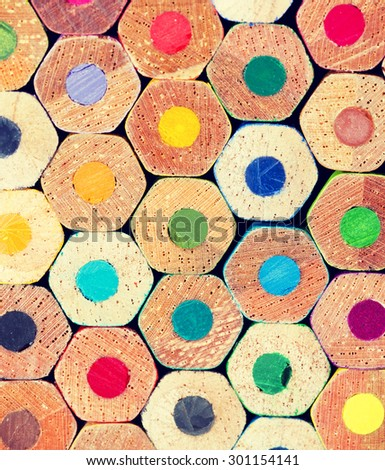 A set of colorful pencil ends. Image has a vintage effect applied. - stock photo