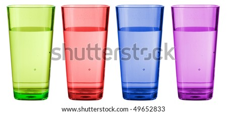 A set of colorful plastic cups isolated on white. - stock photo