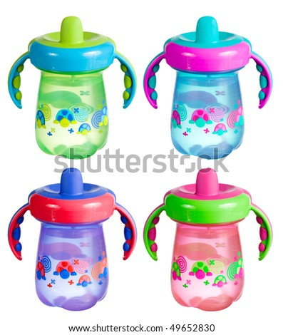 A set of colorful sippy cups isolated on white. - stock photo