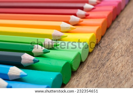A set of colors of pencil and clay on wooden - stock photo