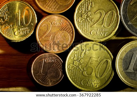a set of columns of different euro coins - stock photo