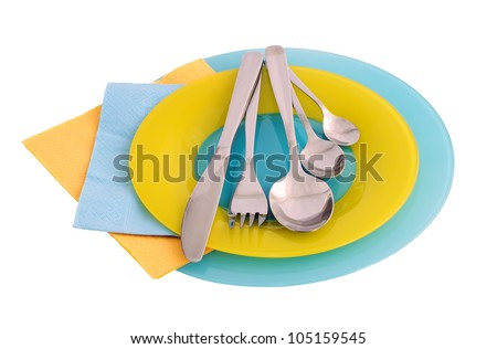 A set of cutlery on a plate with paper towels (isolated)