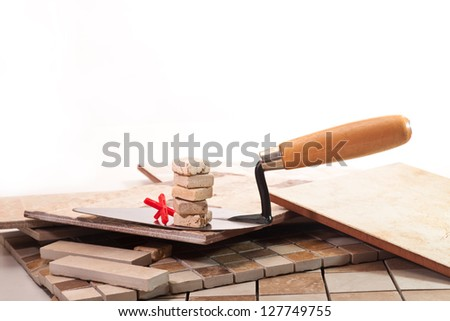A set of decorative stone and tile with a trowel - stock photo