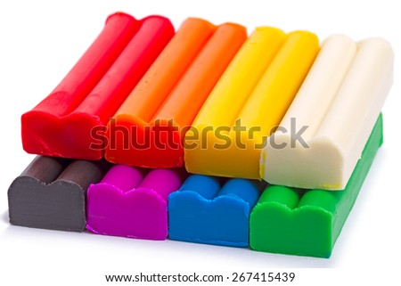 A set of  eight colors of Modeling clay Isolated on white background - stock photo