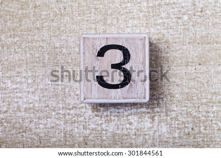 a  set of figures on wooden cubes 3 - stock photo