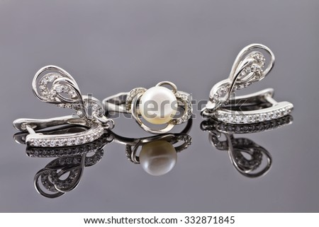 A set of fine silver jewelry : ring and earring - stock photo